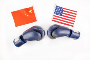 Creative top view flat lay of Two boxing gloves with China and USA flag and copy space on white