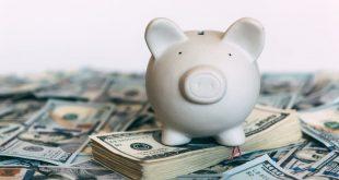 Piggy moneybox with dollar cash